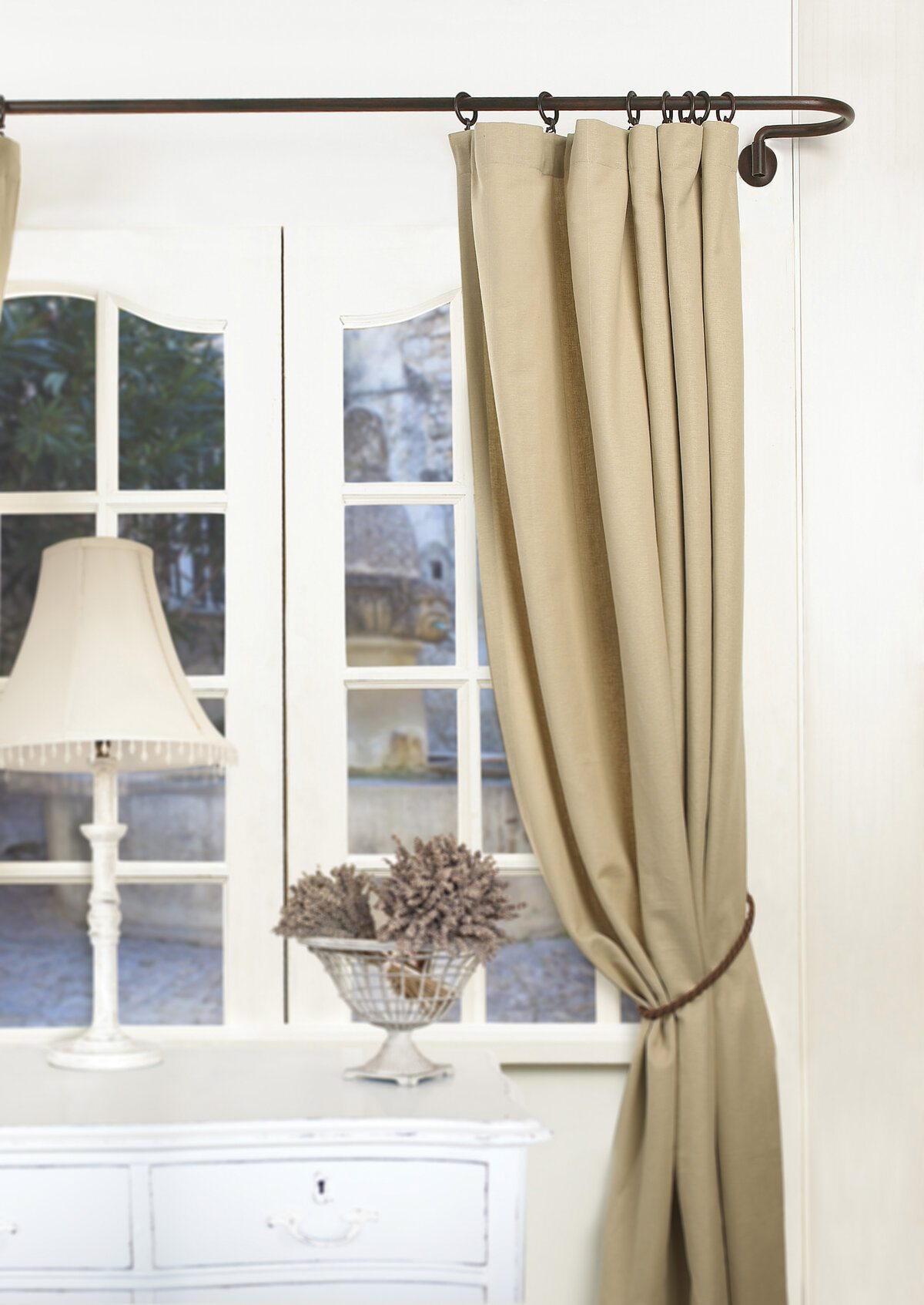 Classic room atmosphere with white sash window and pastel colored curtain