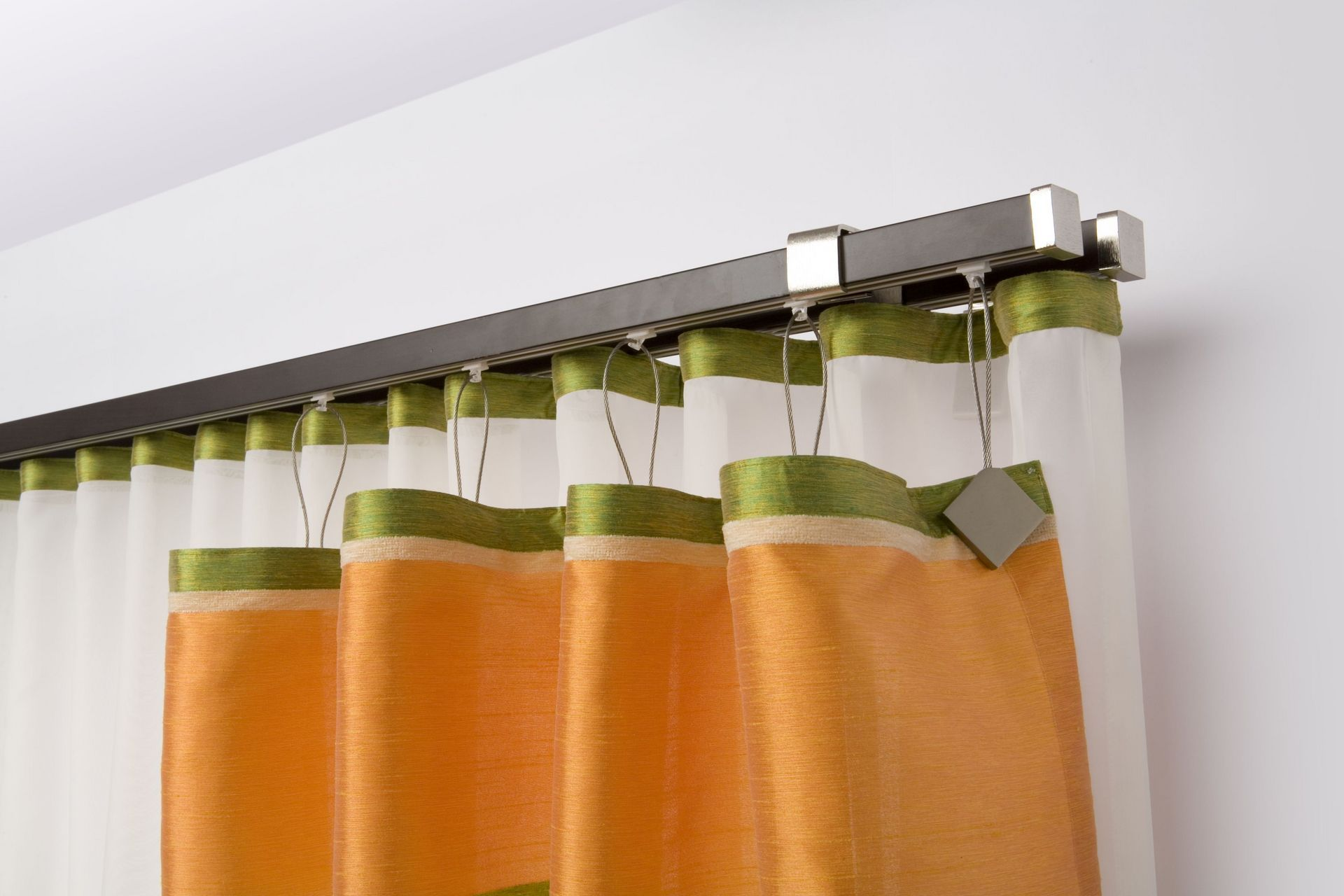 Orange curtains at the closed type of steel rod