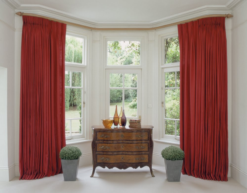 Chic bright red curtains for bay sash window in classic white interior
