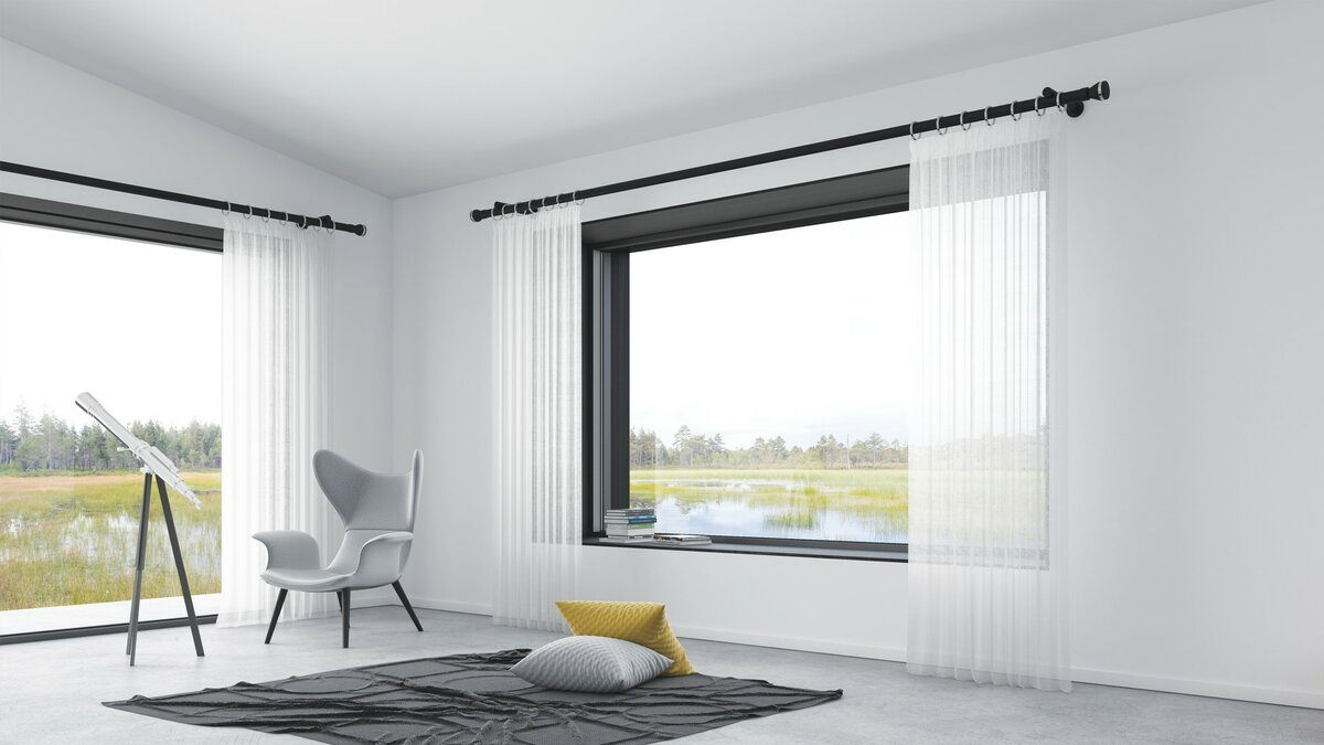 Panoramic window with translucent tulle on black rod for amazing minimalistic designed living