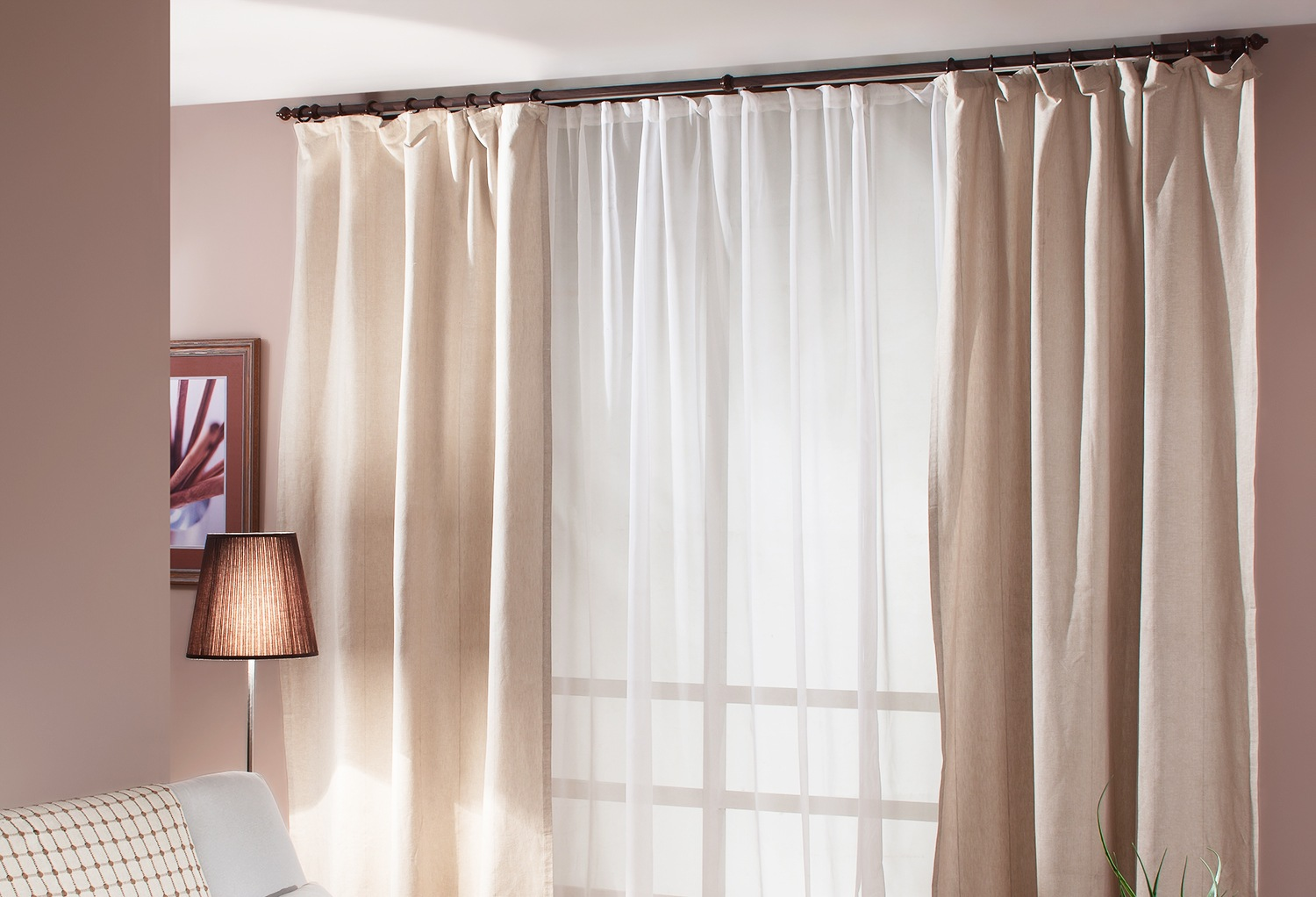Peach colored room with pastel curtains