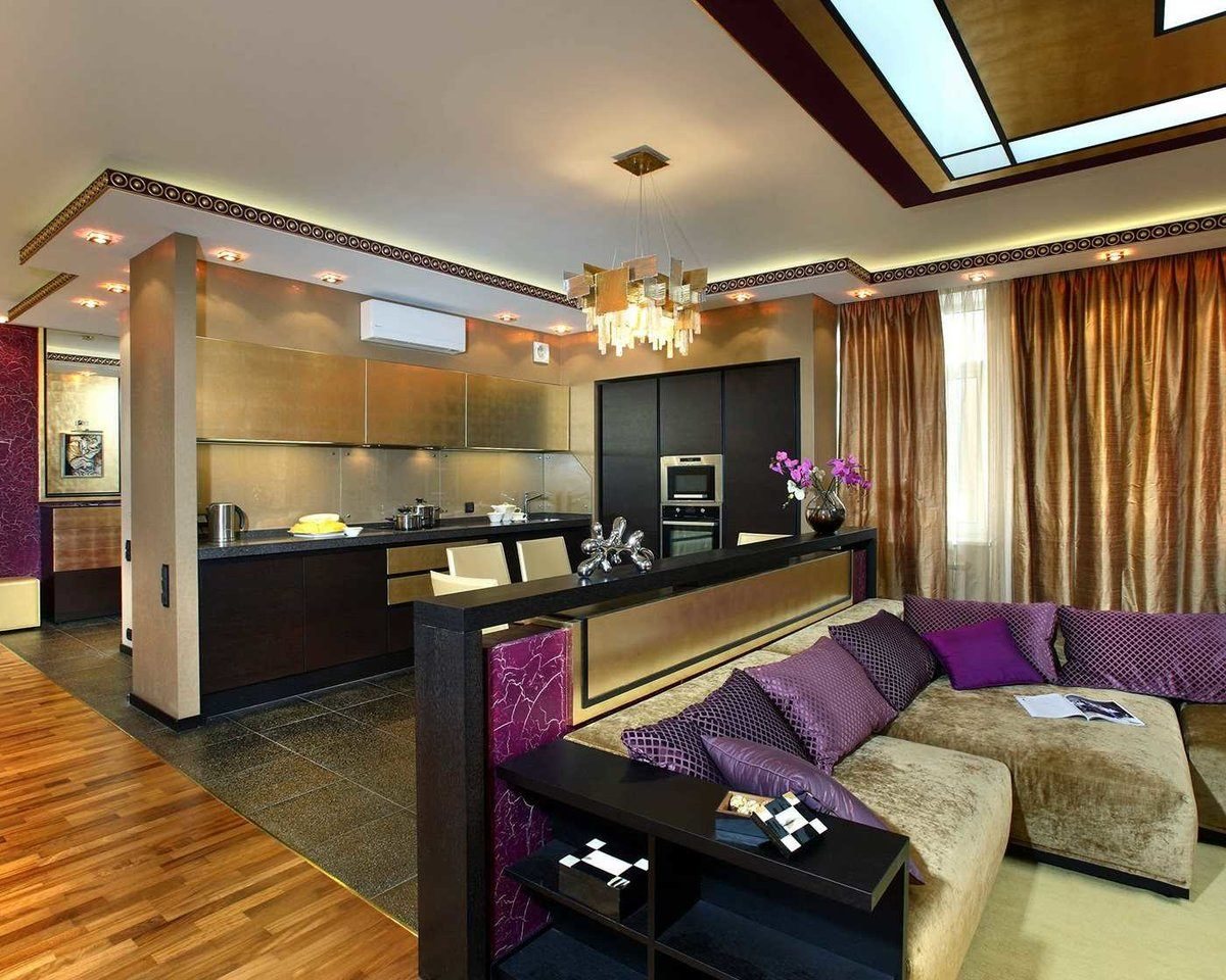 Art Deco Living Room Interior Design Ideas. Dark colored room with complex lighting and purple accents at the large sofa