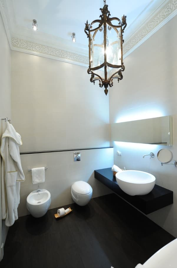 The Perfect, Eco Friendly Bathroom Should Always Include A Bidet. Small area with LED backlight and white tiled walls