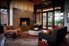 6 Ways You Can Use Cleaner Energy Without Putting Panels on the Roof. Modern natural oriented chic interior design of the house with African touch and electric fireplace