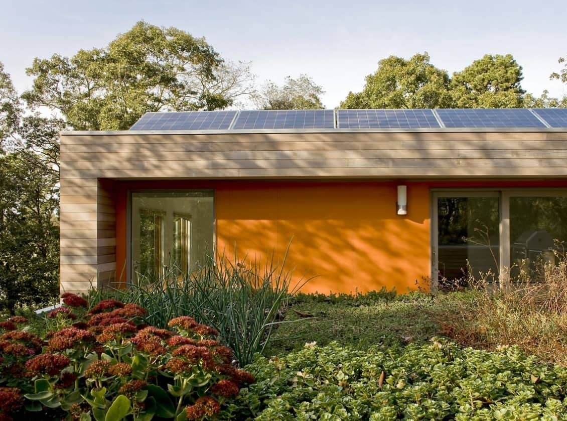 8 Tips to Conserve Energy in Your Home. Casual designed house with yellow facade and sustainable technologies inside