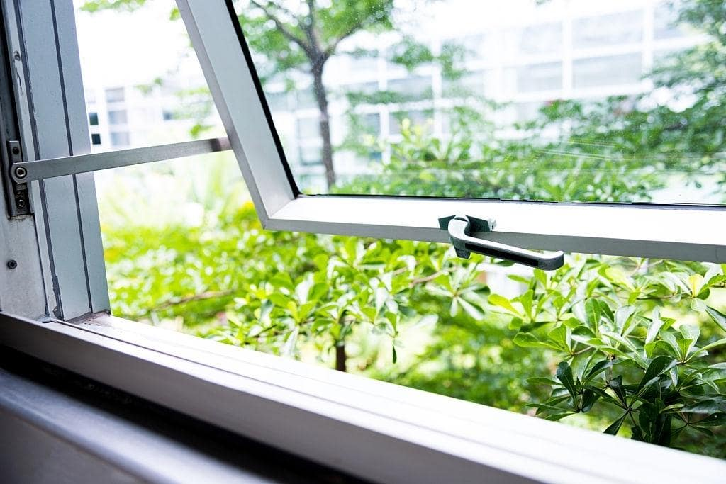 Facts About Laminated Glass Windows That Make Them Preferred Choice. Opened windowpane with bottom opening