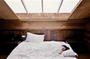 Making the Most of a Small Bedroom. Skylight at the cottage bedroom trimmed with wood