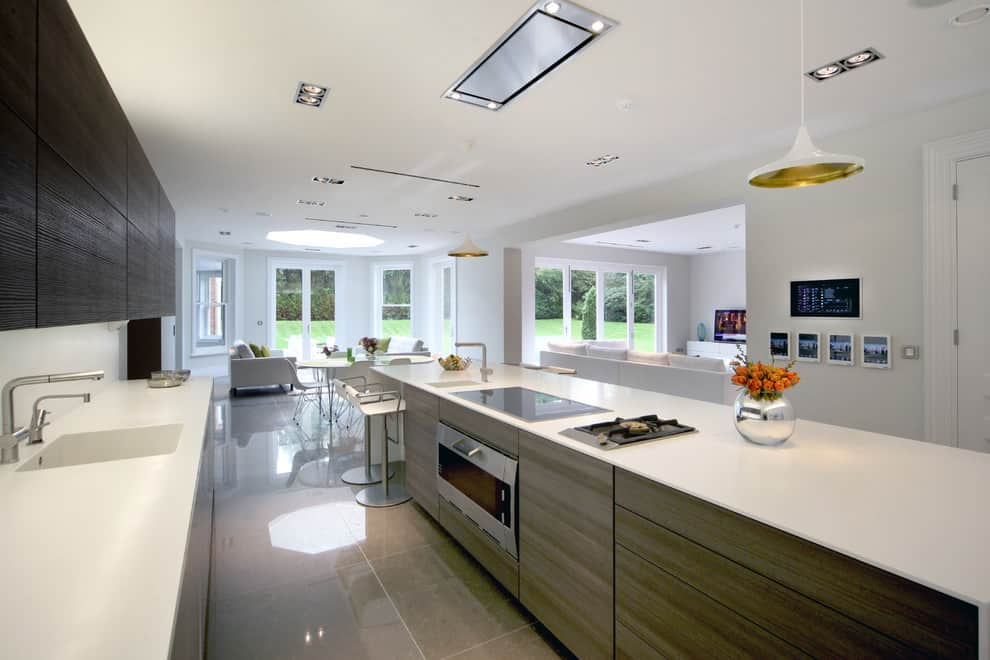 Multi-Level Lighting as Effective Way to Set Accents and Emphasize Interior. Stunning modern kitchen design with glossy floor and ideally white ceiling