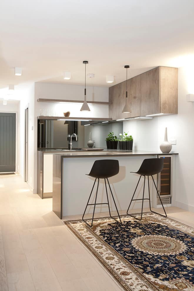 Great modern design of the kitchen with bar counter and full of artificial light