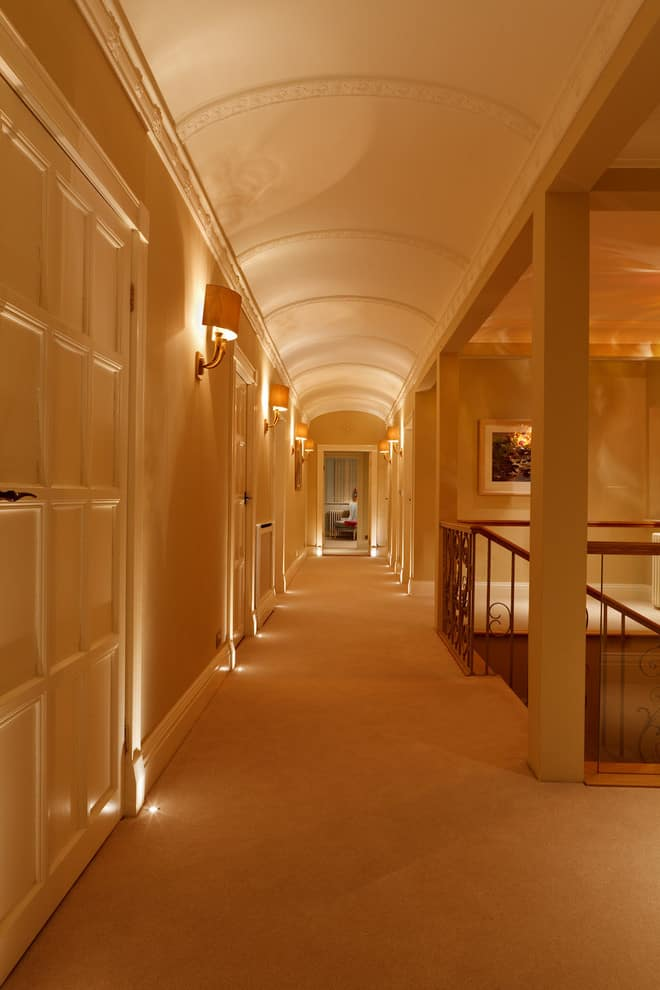 Semi-columns in the long corridor with wall-mounted fixtures