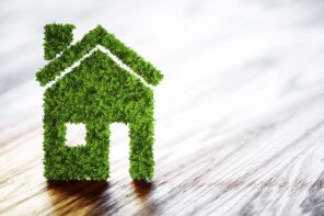 Eco-Friendly Homes: 7 Ways to Update Your Home and Go Green. Green house on the laminated floor