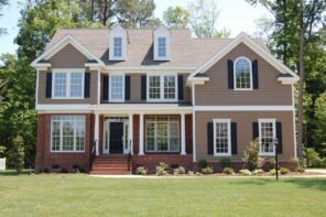 How To Bring Your Vinyl Siding Back To Life. Classic English styled house with gray facade