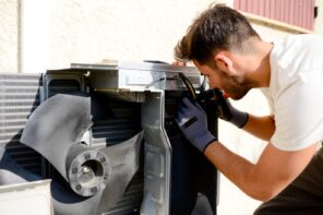 6 Signs It's Time to Say Goodbye to Your Old AC Unit. Repairing the AC by specialist at the roof