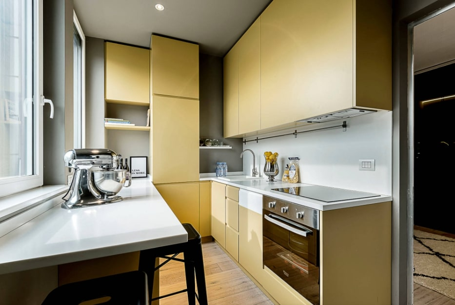 Narrow Kitchen Design Features and Modern Decoration Solutions. Nice mustard colored furniture facades