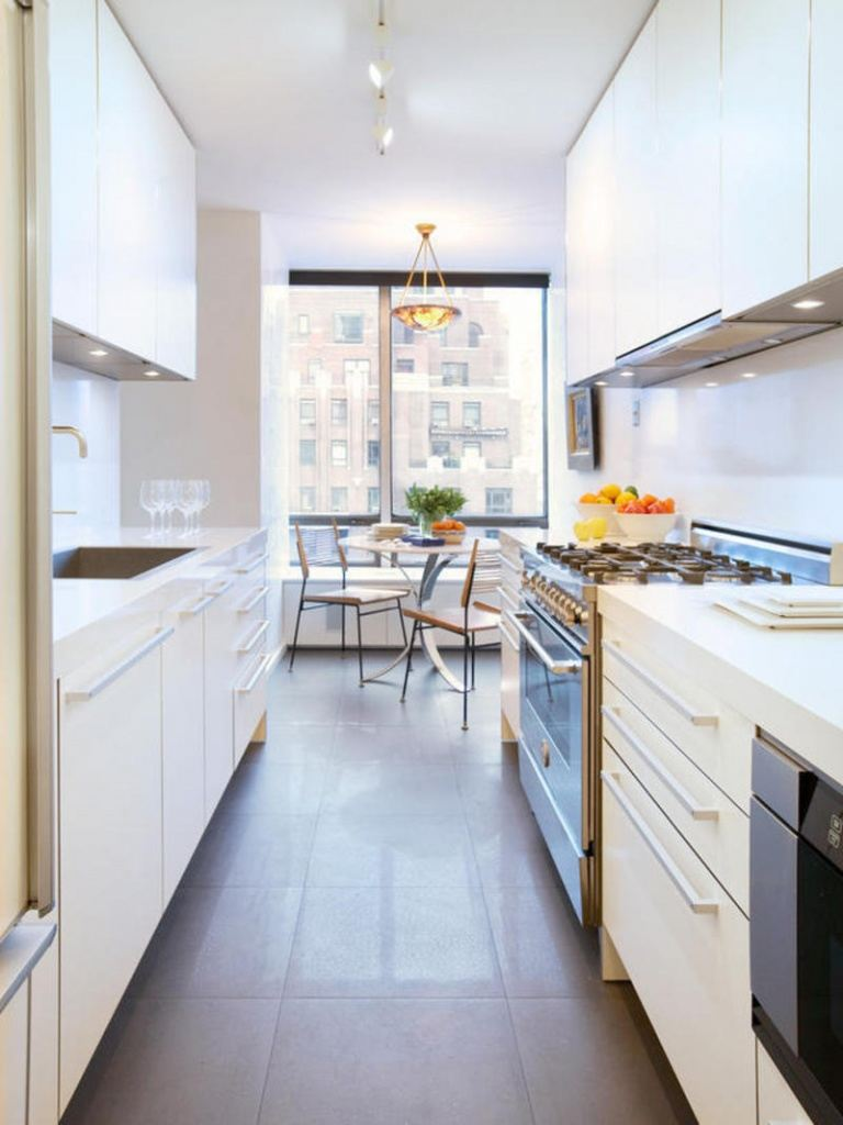Great dark limated floor for white colored kitchen with glossy facades