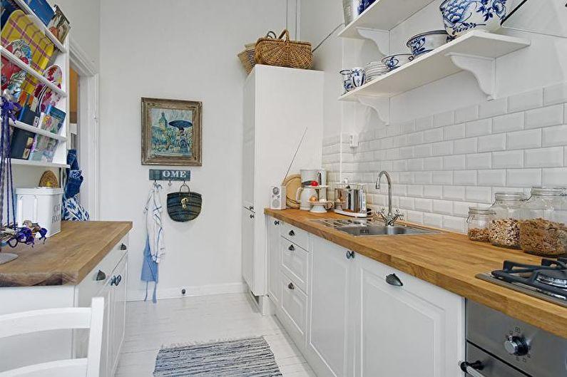 Metro tile for backsplash and white overall scheme of the kitchen design