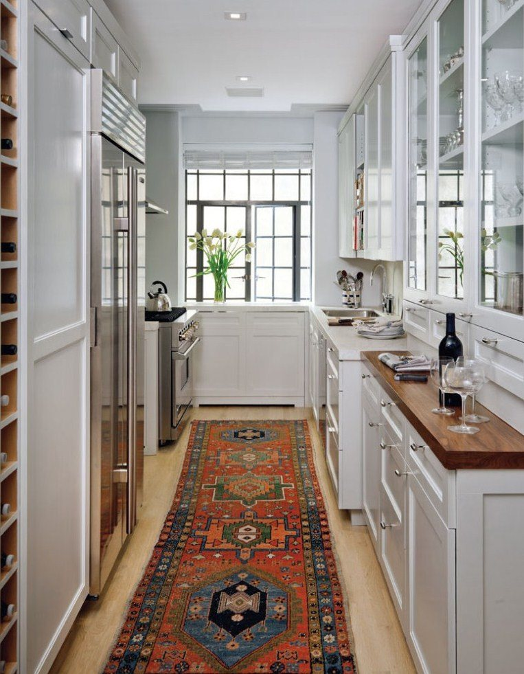 Classic narrow kitchen is profitably emphasized with carpet