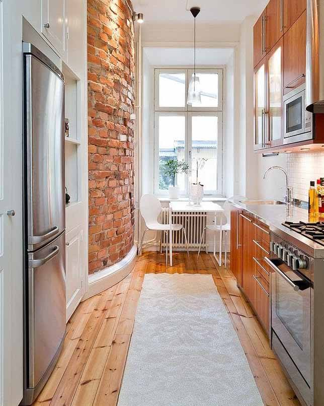Loft touch in the small narrow kitchen with open brickwork and rough treated hardwood floor