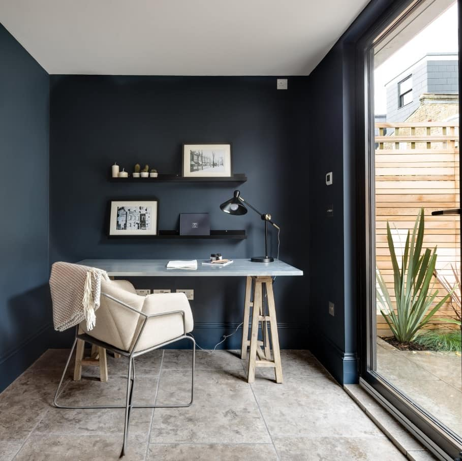 4 Tips to Create a Productive Office Space. Great modern dark blue workspace emphasizing at the small nook near the panoramic window