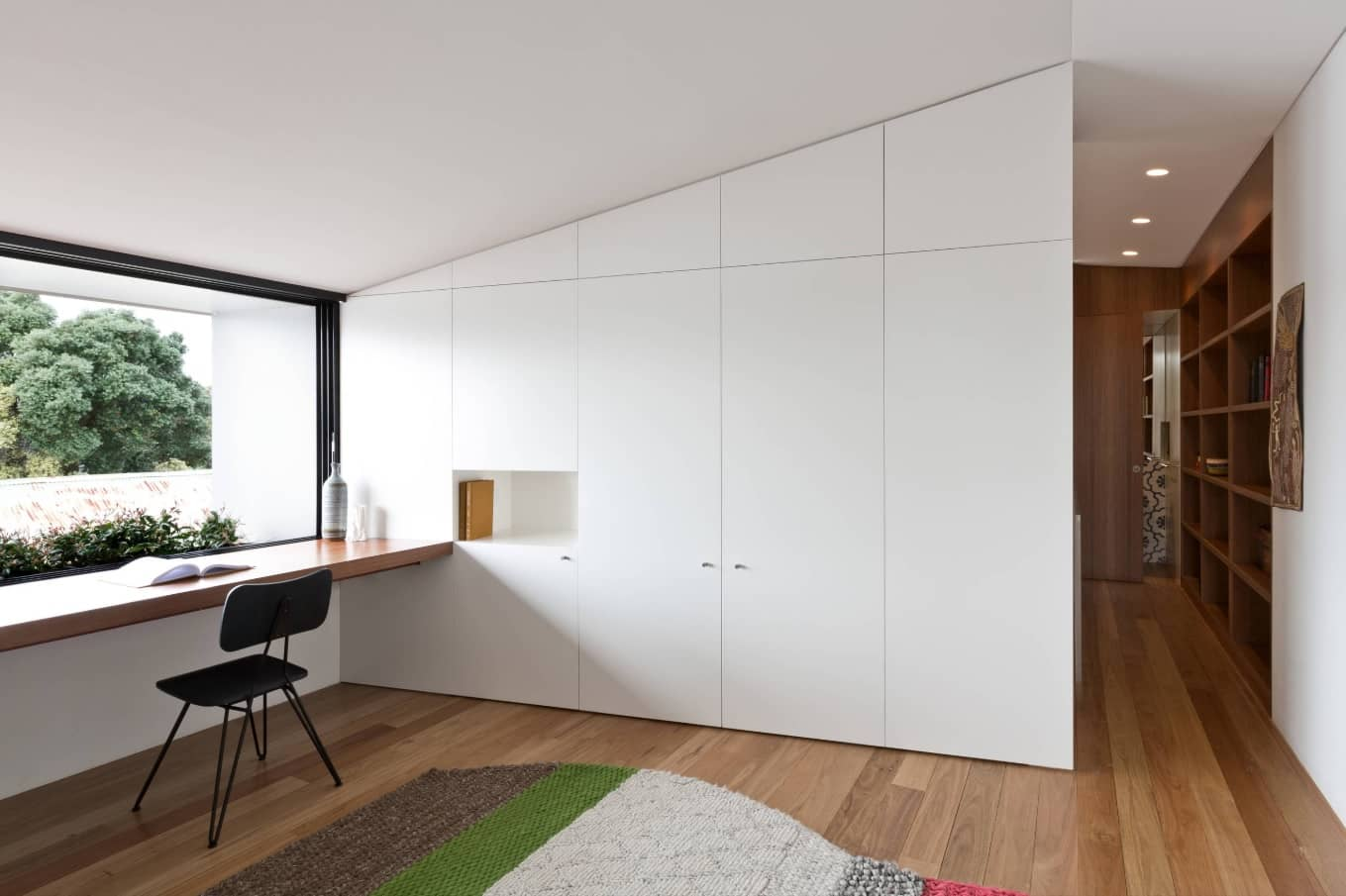4 Tips to Create a Productive Office Space. Scandinavian minimalistic interior decoration with seamless storage wall-height cabinet