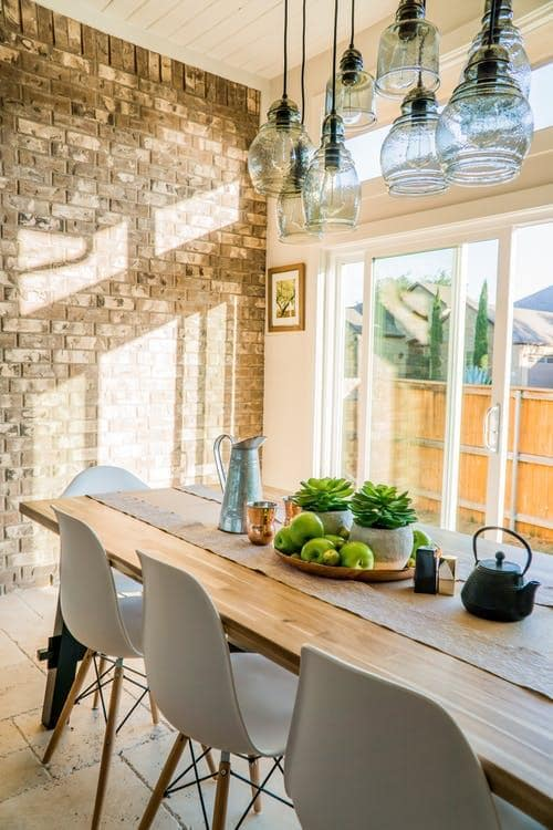 Settling Down and Settling In_ Renovation Ideas to Create Your Forever Home. Great sunny dining room interior in low-key casual stykle with retro touch