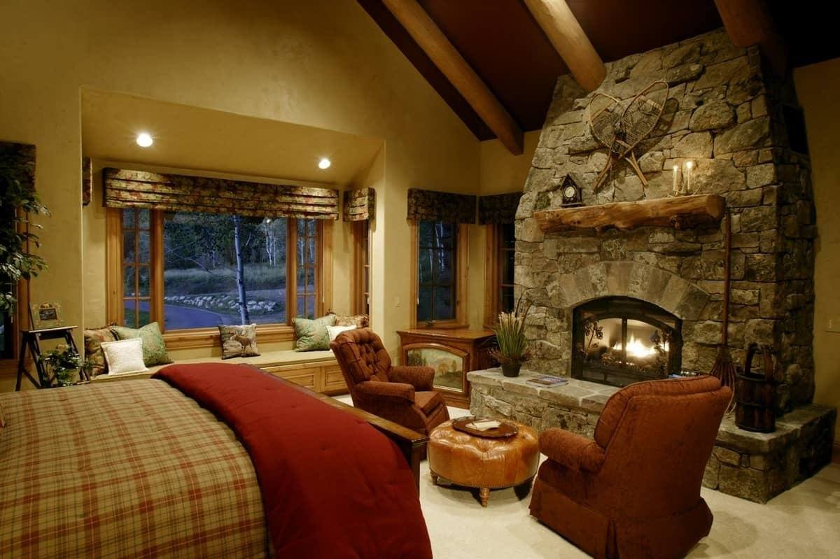 Warm chalet living room with precise spot lighting and large fireplace