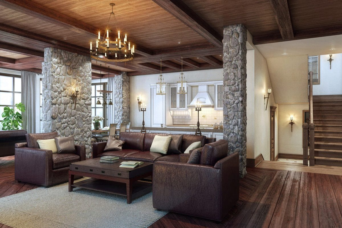 Stone columns and wooden floors to delimit the living zone