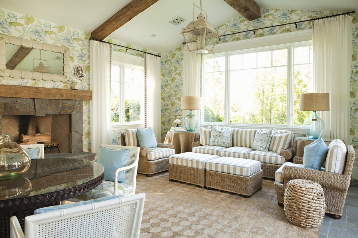 Country Style Living Room Design: Cozy and Romantic Atmosphere. Light and very homey design with pillows on the sofa and upholstered ottoman