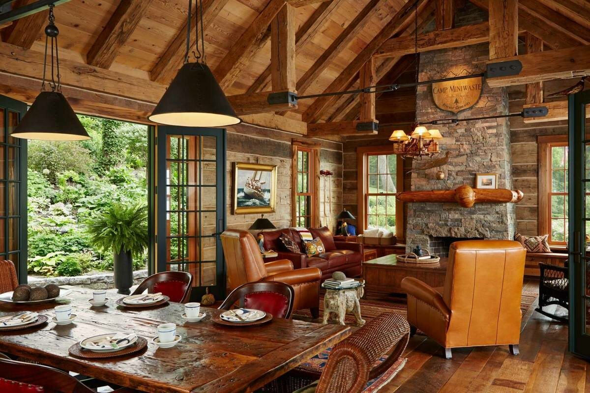 great wooden roof with dangling elements and accent stone wall for summer cottage