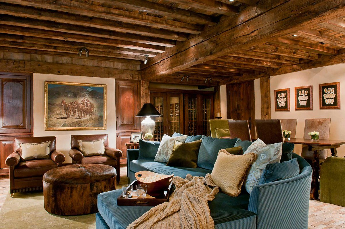 Country Style Living Room Design: Cozy and Romantic Atmosphere. Typical rustic interior design with chalet warmness