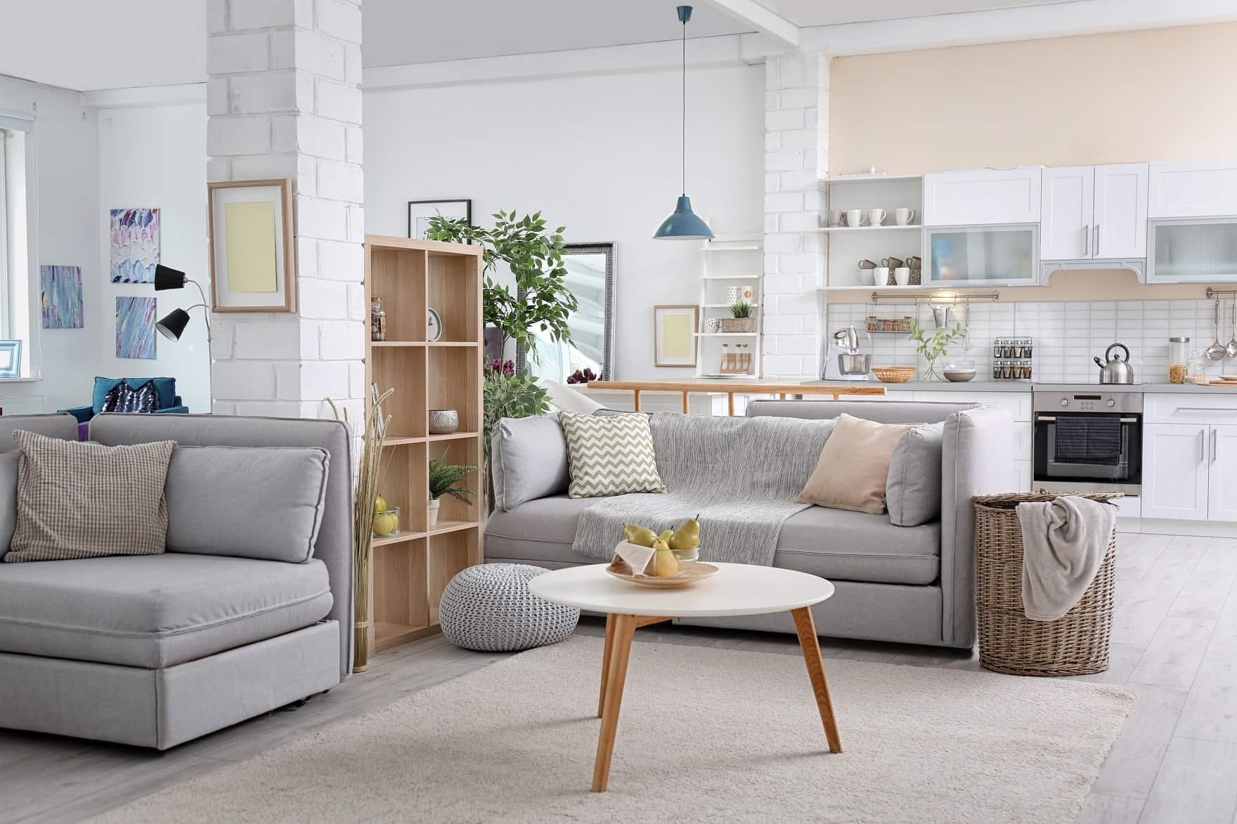 How To Design Your Interior To Make It Look Clean. Casual open layout cottage design with gray furniture and wooden inlays