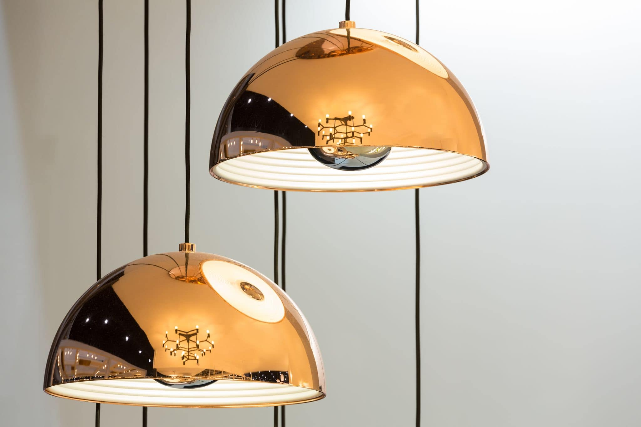 Copper lampshades to add bloom to monochromatic interior