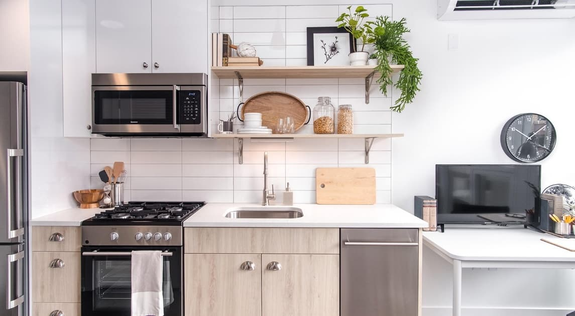 Decorating a Small Apartment? 7 Space Saving Decor Tips You Need to Know as open shelves at the simple designed kitchen