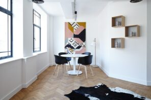 White and black contrast at the dining zone with luxurious cow's pelt to decorate the available parquet floor space