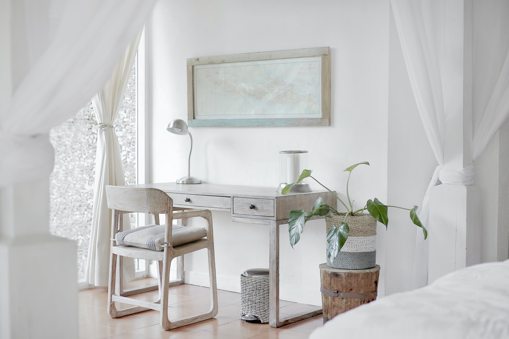 Improvised work desk in the limited space decorated with pastel colors