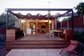 Great idea of cloth awning over the patio zone at the backyard