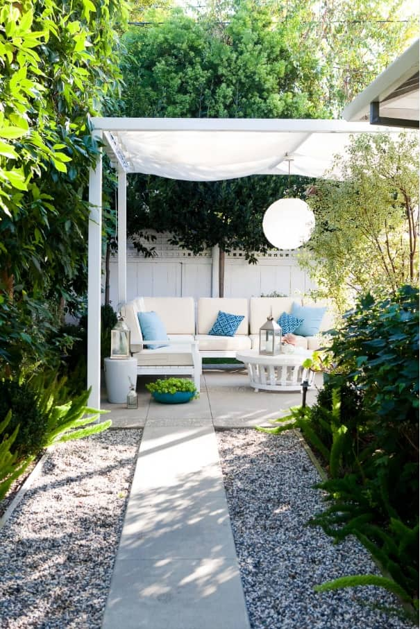 How to Choose Awnings for Your Garden. White colored rest zone amongst the greenery