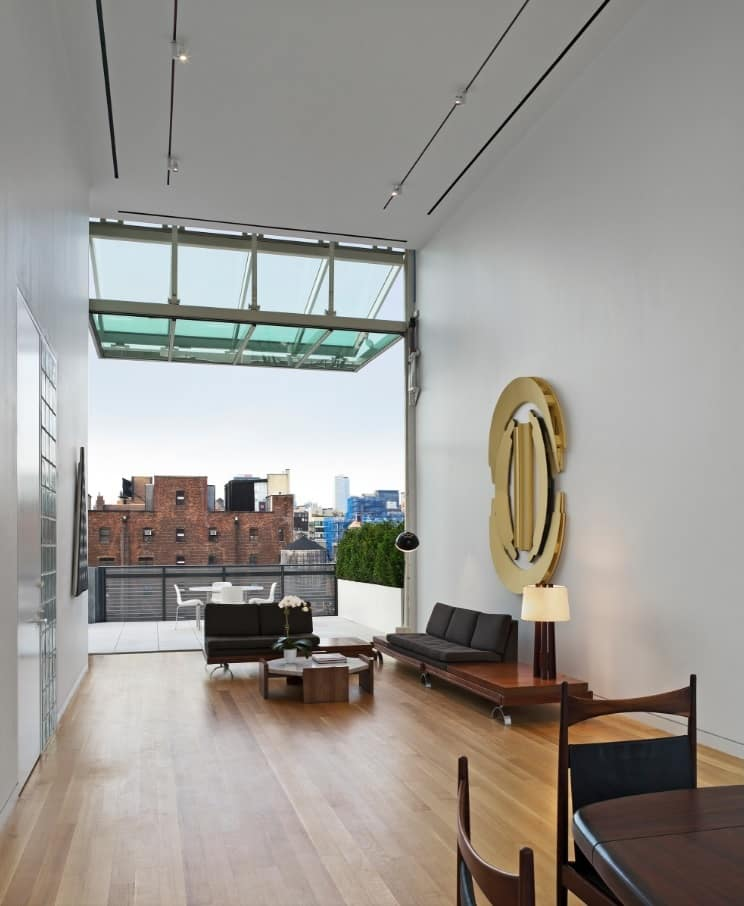 Why an Apartment is the Best Way to Live in Downtown. Glass wall of the modern condo