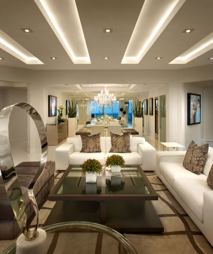 Multilevel ceiling with LED lights in it for ivory colored living room