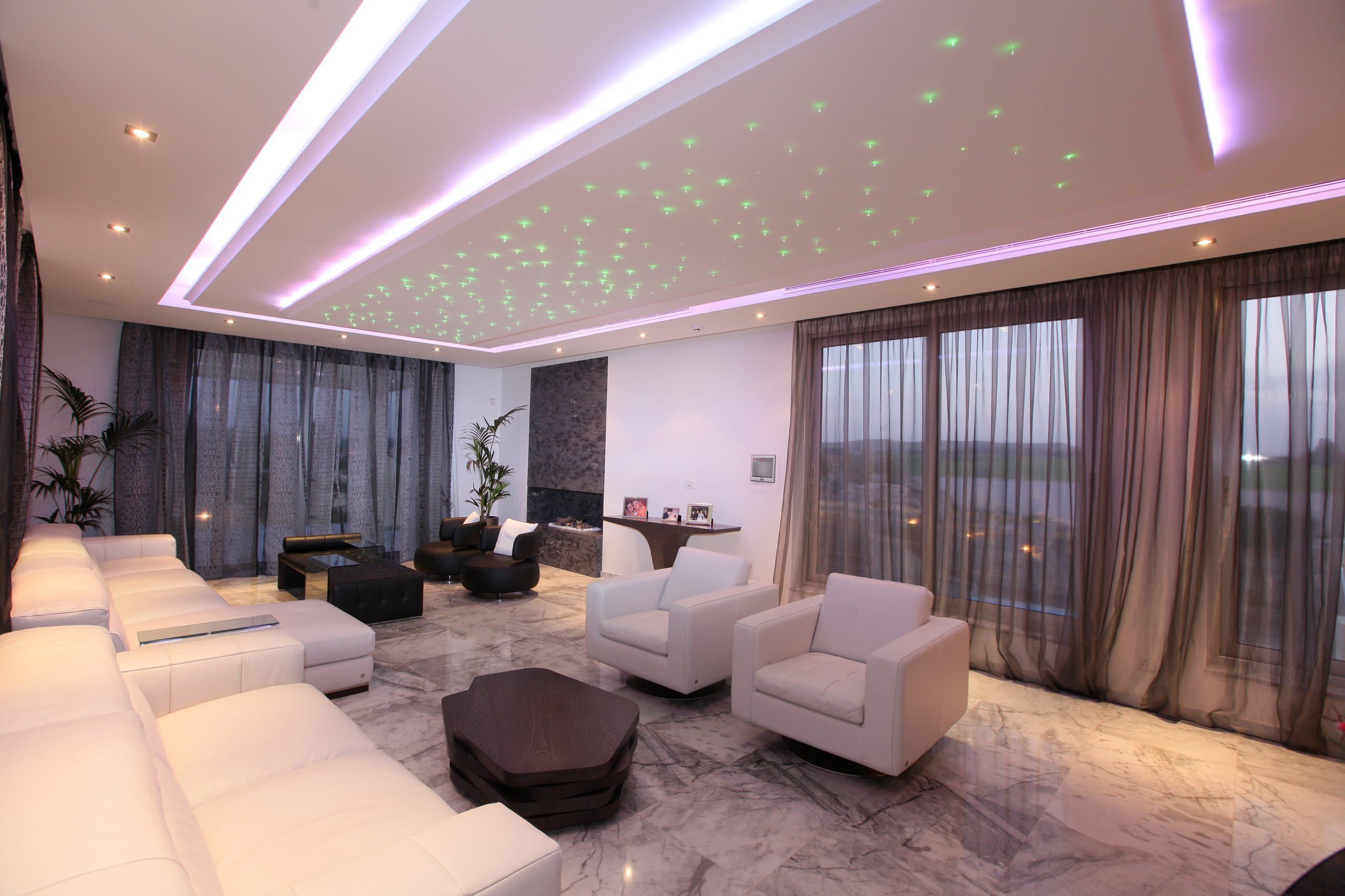 Starry dotted ceiling and marble floor for modern living room with panoramic windows