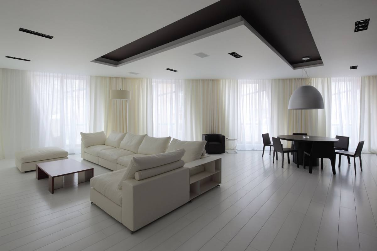 Contemporary styled open layout living room with dark brown inlay in the ceiling