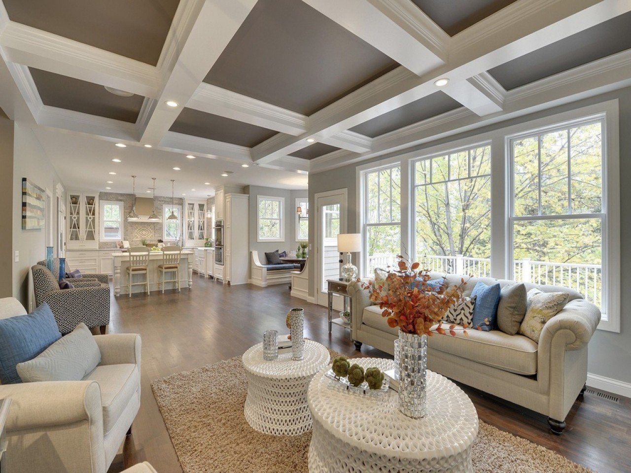 Coffered ceiling for large classic styled living room with light color scheme