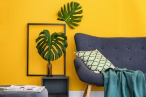 Things to Consider When Doing Major Design Changes in Your Home. Large plant at the background of yellow wall with decorative photo frame