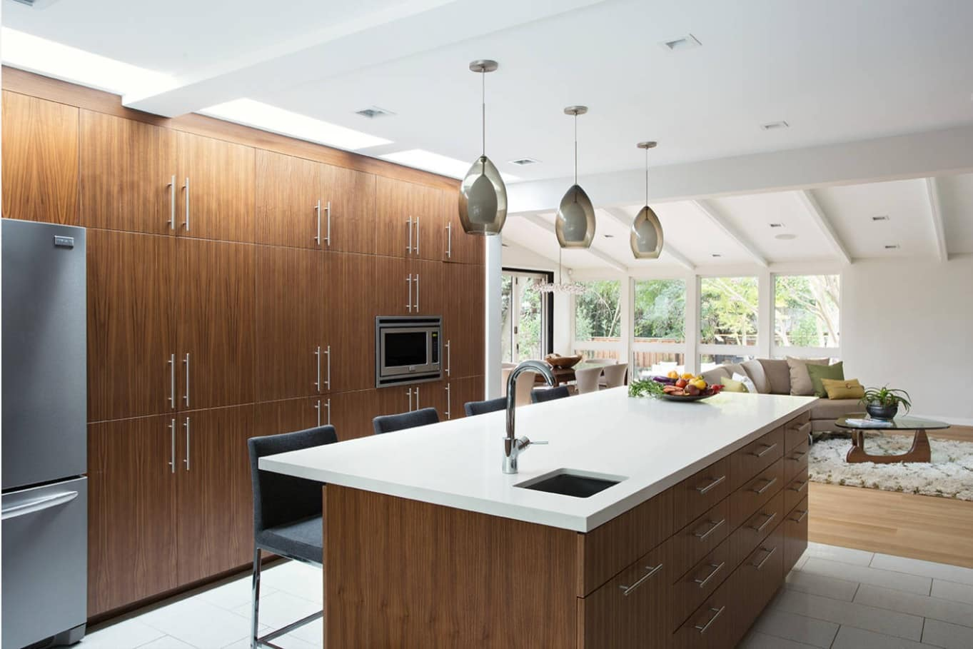 Wooden designed kitchen facades for white colored casual interior full of natural light