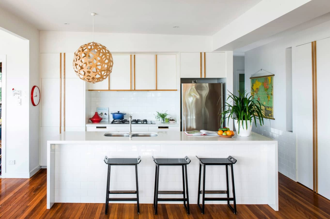 How to Make the Most of Your Small Kitchen. White kitchen with island in Contemporary style and with natural hardwood floor