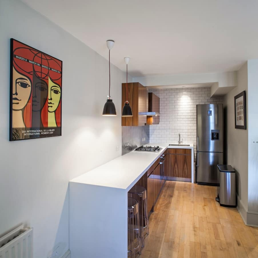 How to Make the Most of Your Small Kitchen. Narrow kitchen zone with long lighted worktop