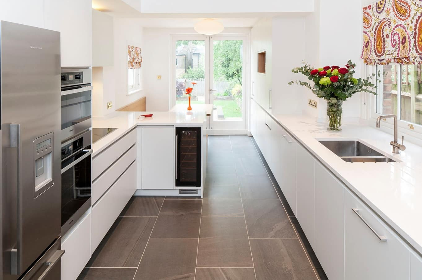 How to Make the Most of Your Small Kitchen. Faux concrete tiled floor and white minimalistic decoration