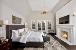 Classic styled bedroom with black framed bed and foam mattress