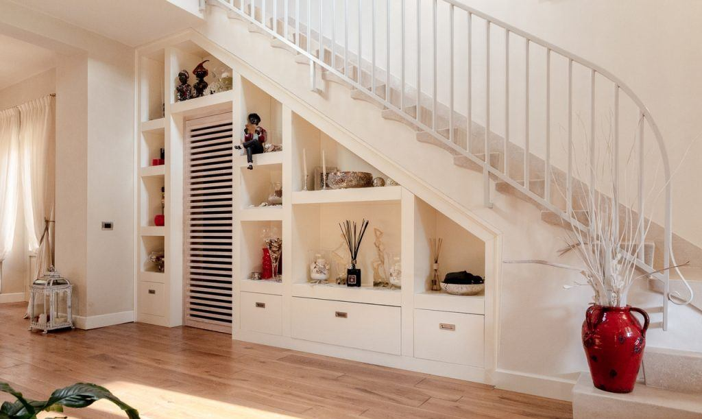 Open shelves under the stairs for personal things