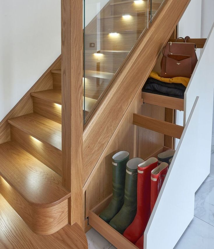 Storage under the Staircase: Different Ideas and Functional Spaces. Backlighted steps and retractable footwear shelf